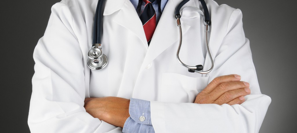 close up image of a doctor in a white jackets with a stethoscope