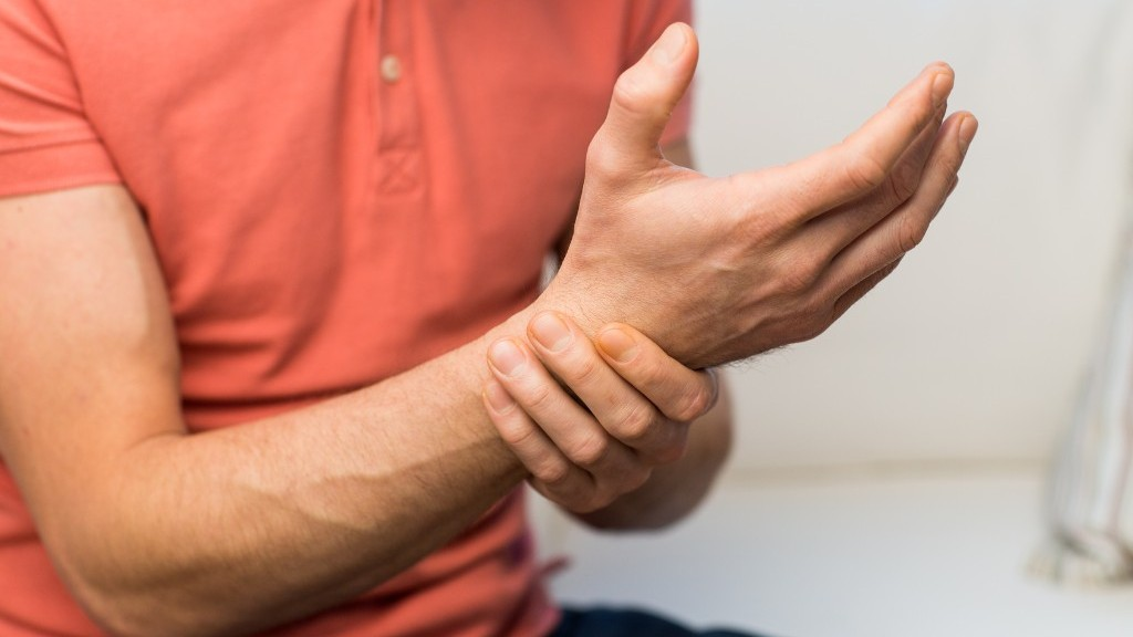Patient holding his wrist in pain