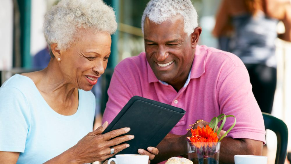 Elderly couple looking at an iPad