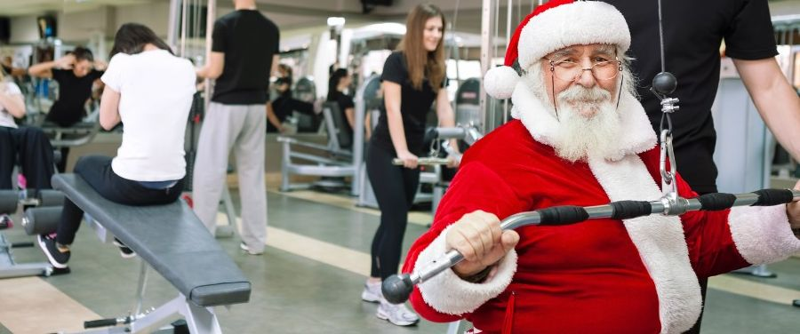 Santa Claus working out at the gym.