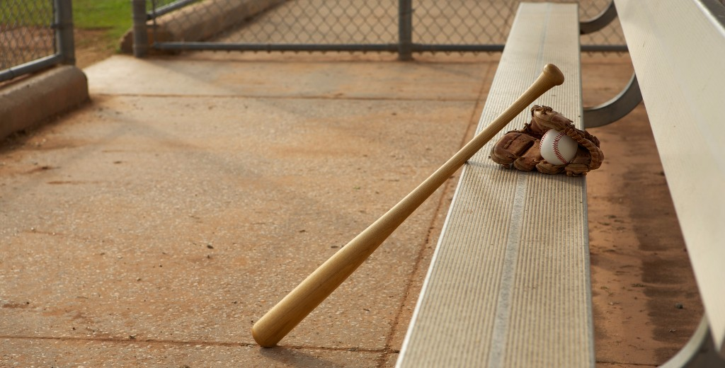 baseball bat and glove at a baseball field