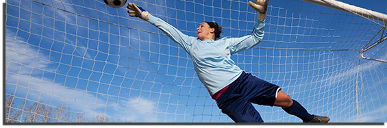 Woman playing goalie in soccer