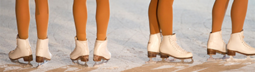 Shot of figure skaters' feet in skates