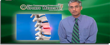 Doctor Qureshi discussing a slipped disc