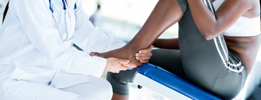 Doctor evaluating a patient's ankle