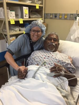 Emily Crow with Titus recovering from his knee replacement performed during a medical mission trip | Muir Ortho | SF Bay Area, CA